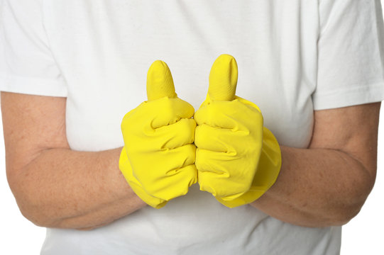 Hands in yellow gloves  showing thumbs up