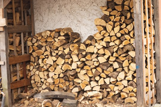 Firewood stacked in a woodshed (Germany, Europe)
