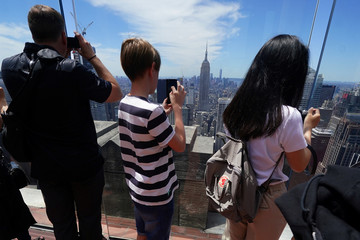 People take photos of the Empire State Building from the Top of the Rock in the Manhattan borough of New York City