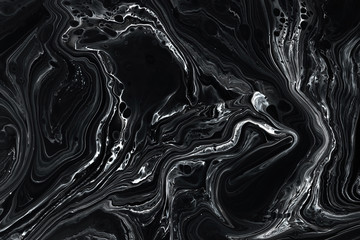 Abstract black marble texture background. Oil, acrylic paint mix pattern.