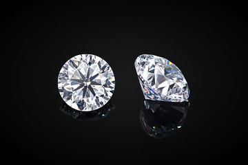 Diamond isolated on black background. Luxury colorless transparent sparkling gemstone diamond round shape cut