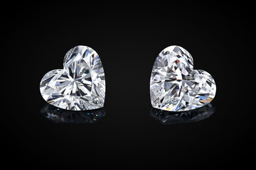 Diamond isolated on black background. Luxury colorless transparent sparkling gemstone diamond heart shape cut
