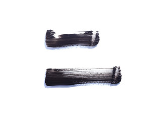 Two black mascara liquid swatches