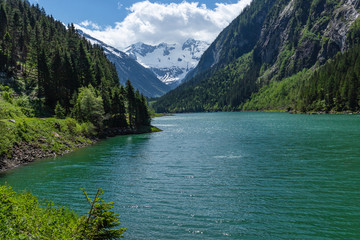 Wall Mural - Panoramic view of Lake Stillup in the Alps, Zillertal Alps Nature Park, Austria, Tyrol