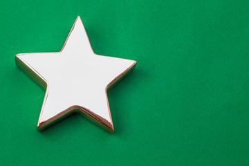 Golden Xmas star on green