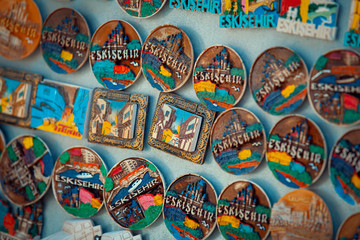 group of handmade colorful magnet souvenirs at marketplace