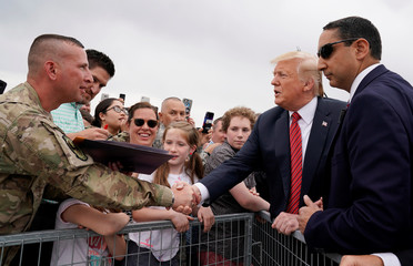 U.S. President Trump shakes hands with a U.S. serviceman after his arrival at at Offutt Air Force Base in Bellevue, Nebraska