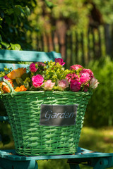 Basket with many colorful summer flowers