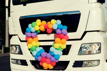 Heart shape balloons in front of a truck during the Sofia Pride parade Selective focus