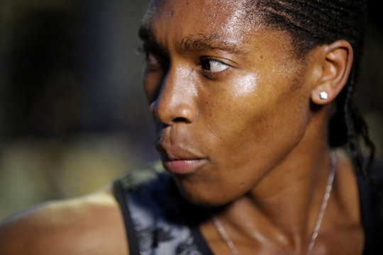 South African athlete Caster Semenya speaks with journalists after she raced during a 2,000 metres for the first time after her banin France