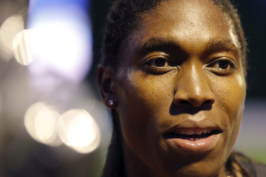 South African athlete Caster Semenya speaks with journalists after she raced during a 2,000 metres at a small meeting in Montreuil, near Paris