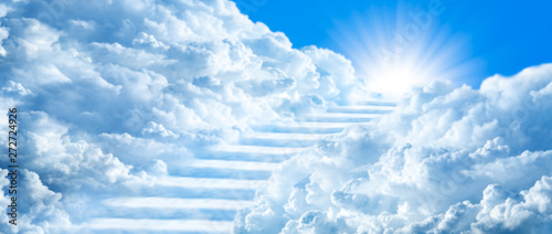 Wall mural Stairway Curving Through Clouds Into The Light Of Heaven With Blue Sky