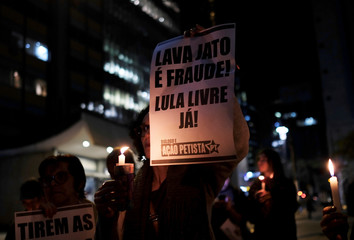 A woman holds a sign during a protest against Brazil's Justice Minister Sergio Moro in Sao Paulo