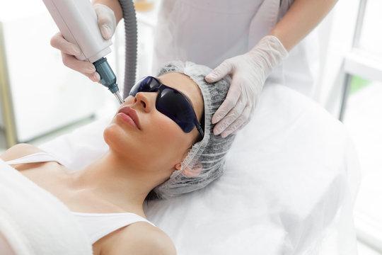 Nice pretty woman receiving laser skin treatment
