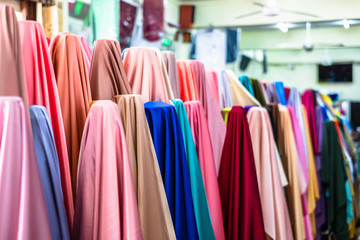 Colorful of many fabric rolls selling in market stall shop. Fashion desig concept. Wall mural
