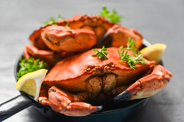 Cooked crab on hot pot and dark background - Seafood boiled red stone crabs