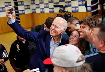 Democratic 2020 U.S. presidential candidate and former Vice President Joe Biden takes a photo with supporters at an event at the Mississippi Valley Fairgrounds in Davenport