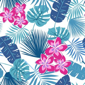 Tropical seamless repeat pattern with hot pink frangipani plumeria flowers and blue leaves
