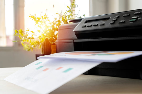 The printer is fully functional,Located on the desk.