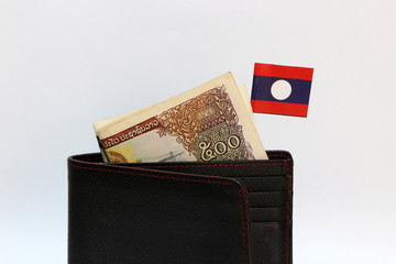 Wall Murals Chicken Five hundreds of banknote currency Lao Kip and mini Laos nation flag stick on the black wallet with white background.
