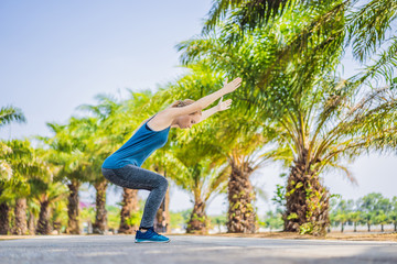 Woman doing yoga in a tropical park