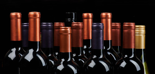 Many wine bottles heads