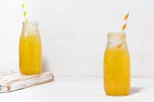 bottles of homemade citrus lemonade on a white background