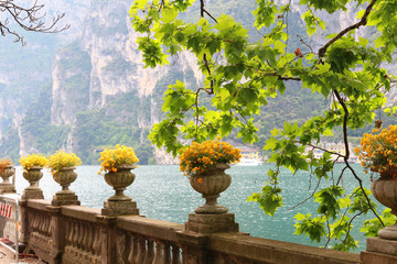 Lovely antique flower pots at waterfront walkway  in Riva at lake Garda (Italy) Wall mural