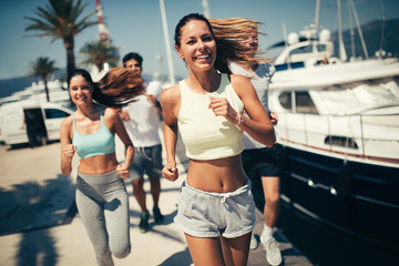 Exercising runners people training outdoors living healthy active lifestyle Fotomurales