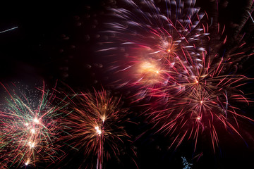 Beautiful sparks from fireworks in the sky at night