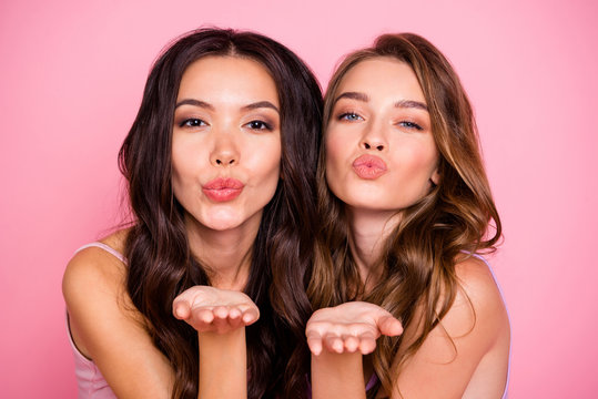 Close up photo of cute charming ladies fellows fellowship send air kiss attract men want date valentine day wavy curly haircut long modern trendy stylish clothing isolated pink background