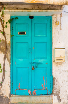 beatiful teal turquoise wooden door with letter box