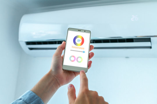 Mobile application on smartphone for adjusting the temperature on the air conditioner. Smart House