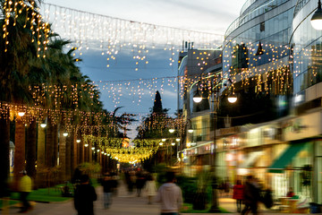 The background of the bokeh of the evening city. Festive Christmas New Year illuminations in city streets Fotomurales