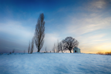 Winter landscape with a beautiful chapel