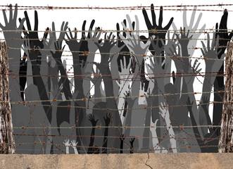 Migrants à la frontière derrière barbelés