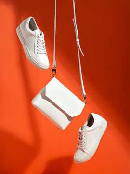 White sport shoes and small bag.