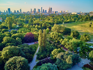 Obraz A beautiful panoramic view of the sunset in a fabulous evening in June from drone at Pola Mokotowskie in Warsaw, Poland -