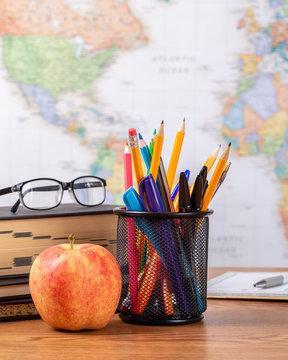 School Teachers Desk With World Map in Background
