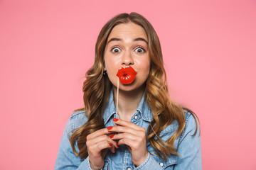 Shocked woman wearing in denim shirt posing with fake lips Wall mural