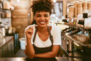 Fototapeta Female barista behind counter obraz