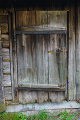 Old wooden door of the boards in the bath.