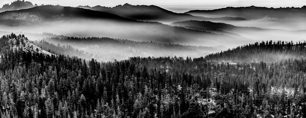 Blank and White Mountains in layers of fog