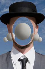 Portrait of a man with sphere in his head