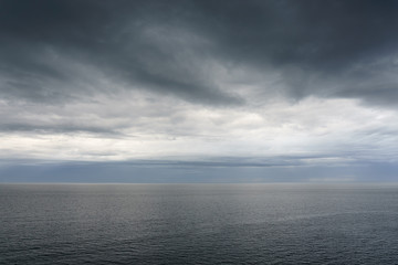 cloudy calm seascape with dark clouds