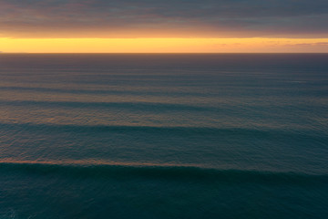 seascape with beautiful waves at the sunset