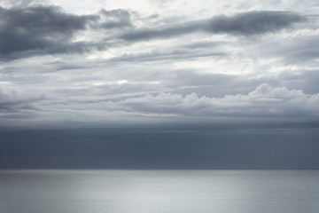 cloudscape with beautiful clouds over the sea