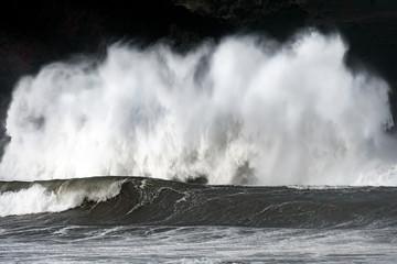 big waves splashing on the coast