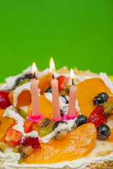 summer fruit cake with candles.