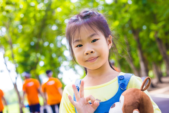 Portrait of asian adorable girl recreation in city park
